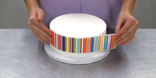 position and place the strip on the side of your cake
